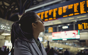 woman looking at departure board
